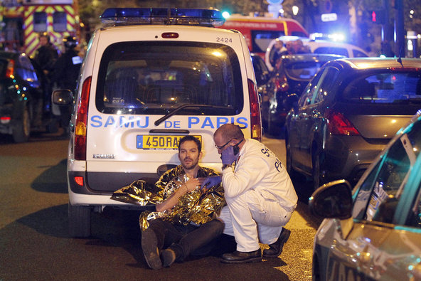 A medic tends to a man on Friday in Paris.
