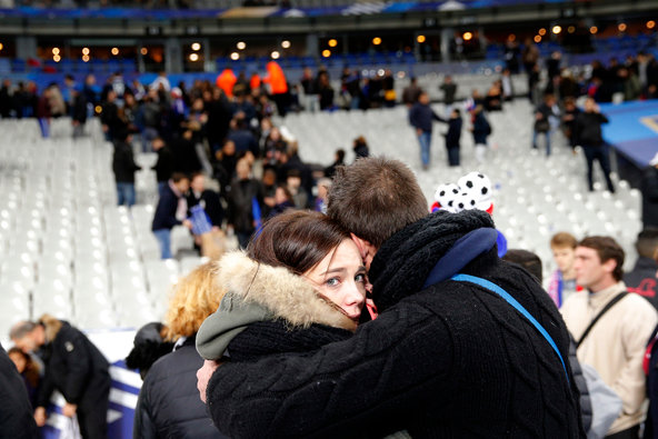 Hundreds of spectators made their way to the soccer field at the Stade de France on Friday after explosions were heard nearby.